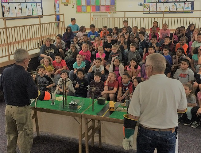 Colorado Springs Utilities presenting safety demo in a classroom