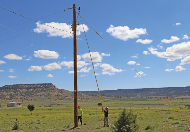 Lineworkers installing a transformer in Navajo nation