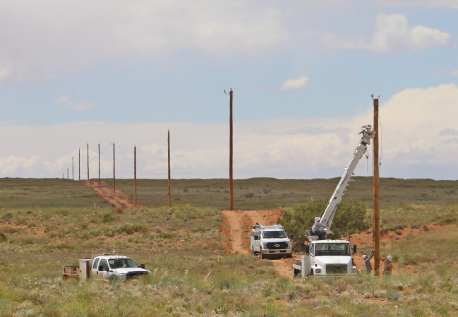 Crew setting poles in Navajo Nation