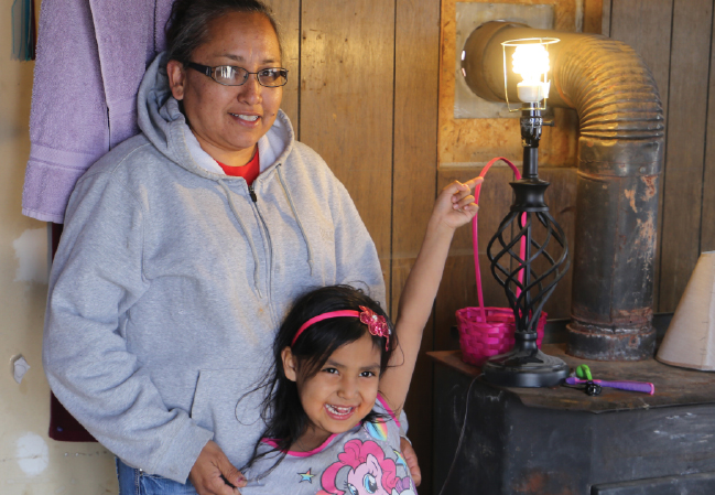 Pauline Yazzie and daughter with light