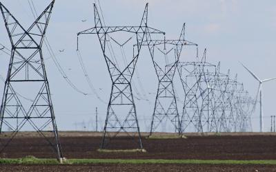 transmission towers over a field, photo courtesy Heartland Consumers Power District