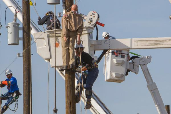 Lineworker at rodeo simulating rescue