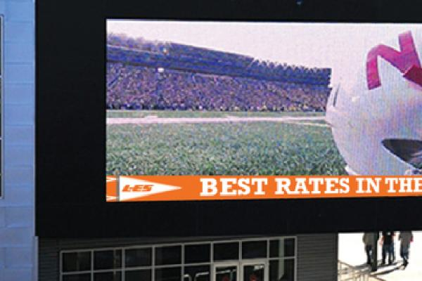 LES big screen at game about rates