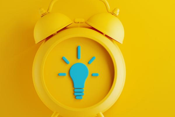 yellow alarm clock on yellow background