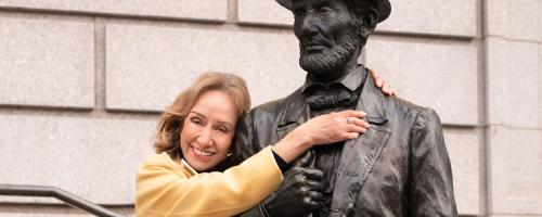 Doris Kearns Goodwin with a statue of Abraham Lincoln