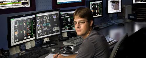 Worker at computer controls at Nearman plant